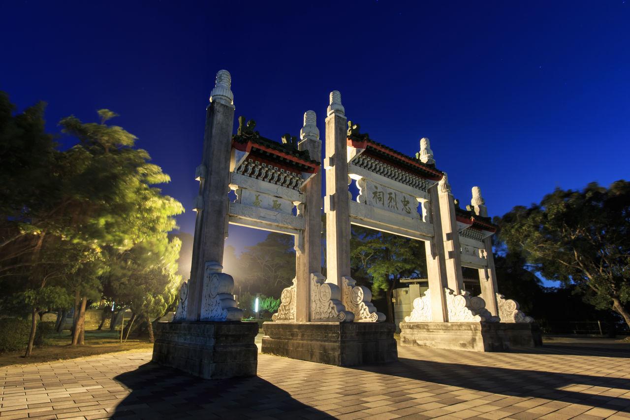 Entrance Of Martyr Shrine Against Sky At Night
