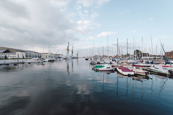 boats moored at harbor against sky Baltic Sea Mecklenburg-Vorpommern Travel Water Reflections Wismar Harbor Boats Germany Ocean Sea Water Waterfront Wismar
