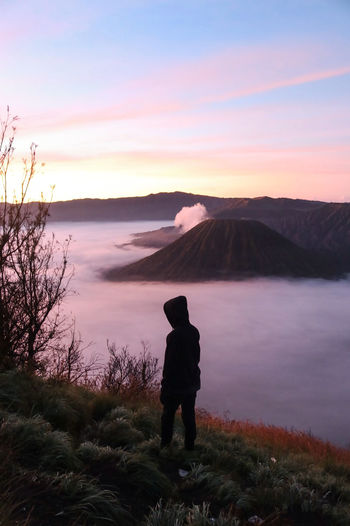 Sunrise at Mount Bromo Wanderlust Travel Water Full Length Men Photography Themes Standing Lake Sunset Mountain Photographer Silhouette Hiker Hiking Explorer Calm Magenta Mountain Peak Mountain Ridge Mountain Range Zermatt Coast Hiking Pole Foggy Backpack Pursuit - Concept