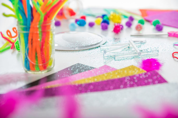 Art And Craft ArtWork Bright Children Creativity Glitter Home Scissors Sparkle Activity Art Childhood Craft Create Glass Glue Stick Material Paper Pipe Cleaner Rainbow Supplies Table Table Top Weekend Activities Window Light