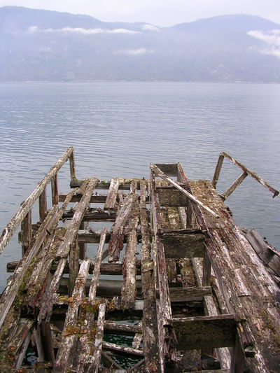 Abandoned Deterioration Mountain Non-urban Scene Old Pier Sea Tranquil Scene Water Weathered Wood - Material