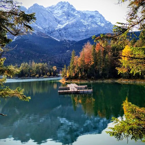 Scenic view of lake by trees and mountains