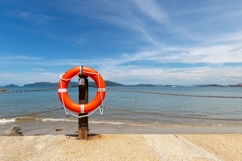 Kota Kinabalu Sabah Malaysia Tanjung Aru Beach Life Buoy Life Saving Ring Water Sea Sky Beach Safety Beauty In Nature Security Protection Nature Scenics - Nature Orange Color Day Cloud - Sky Tranquility Rescue Horizon Over Water Outdoors Inflatable  Wooden Post