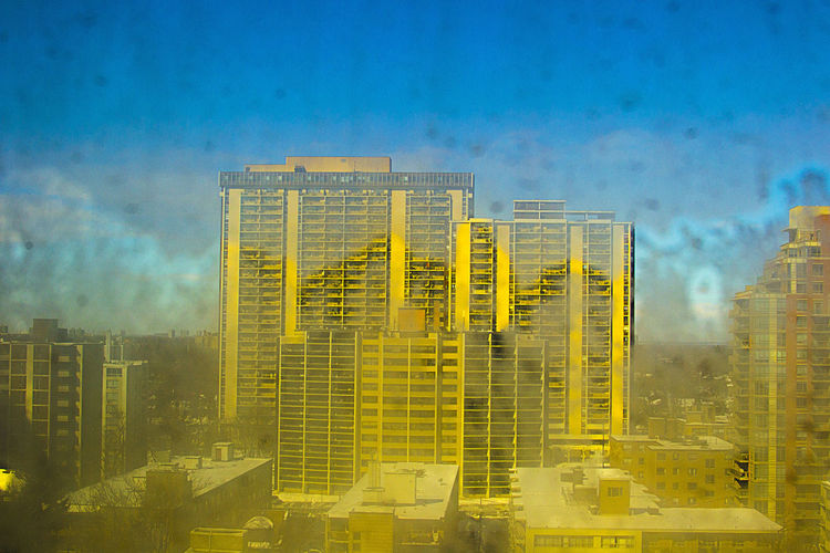 Architecture Blue Building Exterior Building Story Built Structure City City Life Cloud Cloud - Sky Development High Section Modern No People Office Building Outdoors Residential District Romantic Sky Sky Skyscraper Storm Cloud Tall Tall - High Tower Urban Skyline Yellow