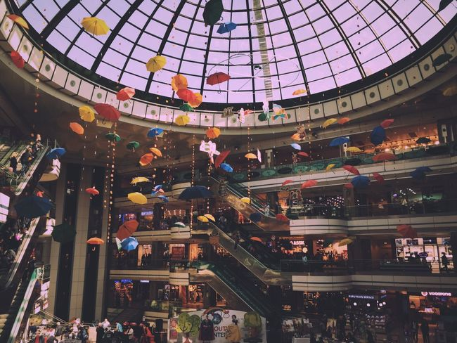Colors Colorful Umbrella Umbrellas Outlet Mall Architecture Large Group Of People Built Structure Men Indoors  Women People Dome Crowd City Adult Adults Only Day
