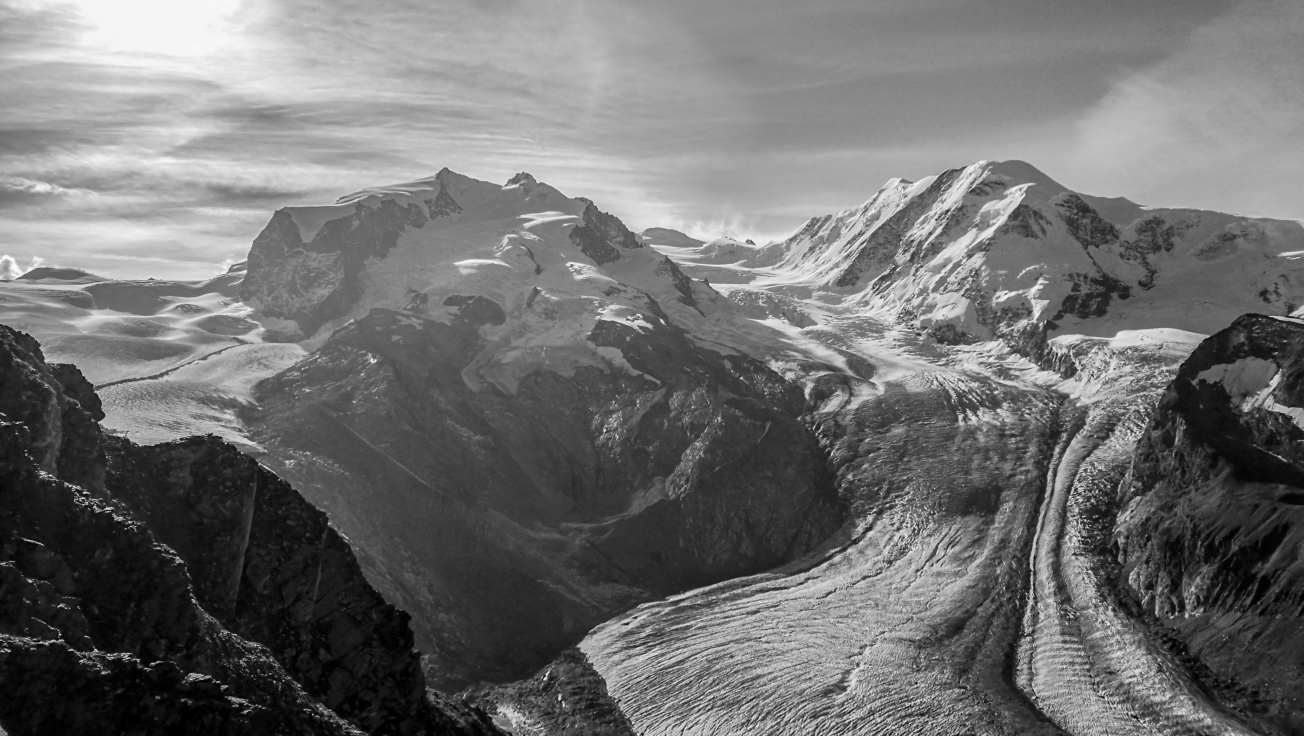 mountain, scenics - nature, environment, landscape, beauty in nature, mountain range, black and white, sky, monochrome, cloud, monochrome photography, nature, snow, travel, travel destinations, cold temperature, land, mountain peak, rock, winter, snowcapped mountain, tranquility, no people, non-urban scene, outdoors, tranquil scene, extreme terrain, tourism, activity, idyllic, dramatic landscape, day, adventure, water