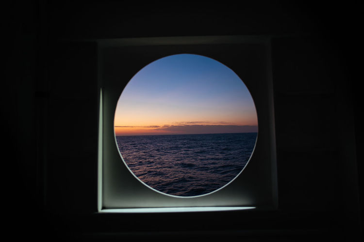 Sunset Ocean View Boat Outatsea Indian Ocean Water Water Horizon Over Water Scenics - Nature Sky Sea Nature Window Horizon Beauty In Nature Geometric Shape Shape No People Circle Vehicle Interior Tranquility Nautical Vessel Mode Of Transportation Idyllic Outdoors
