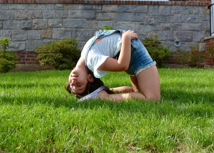 Grass Child One Person Childhood Plant Lying Down Relaxation Smiling Happiness Casual Clothing Day Full Length Emotion Nature Leisure Activity Lifestyles Healthy Lifestyle Side View Offspring Outdoors Hairstyle Acrobatic Activity Gymnastics Gymnast  Acrobat My Best Photo