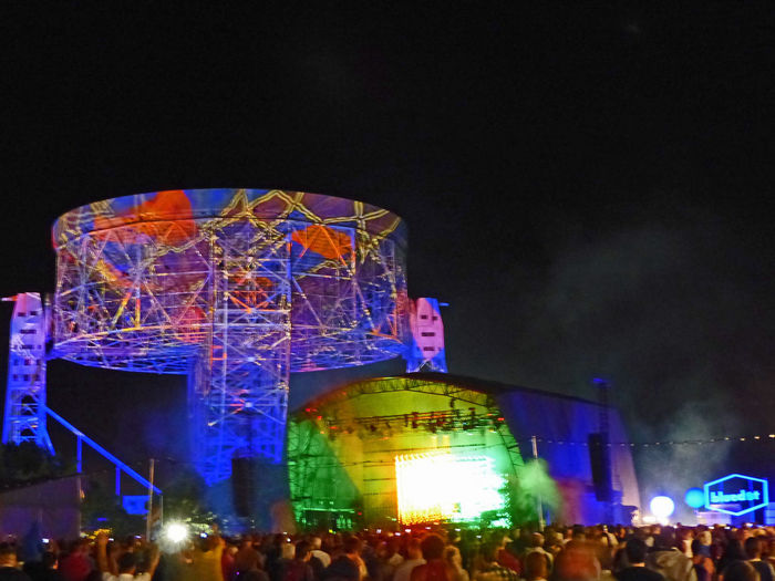 the main stage at the Bluedot Festival Arts Culture And Entertainment Built Structure Crowd Enjoyment Fun Illuminated Jodrell Bank Large Group Of People Leisure Activity Lifestyles Lovelltelescope Multi Colored Musicfestival Night Nightlife Observatory Outdoors Sky Music Brings Us Together
