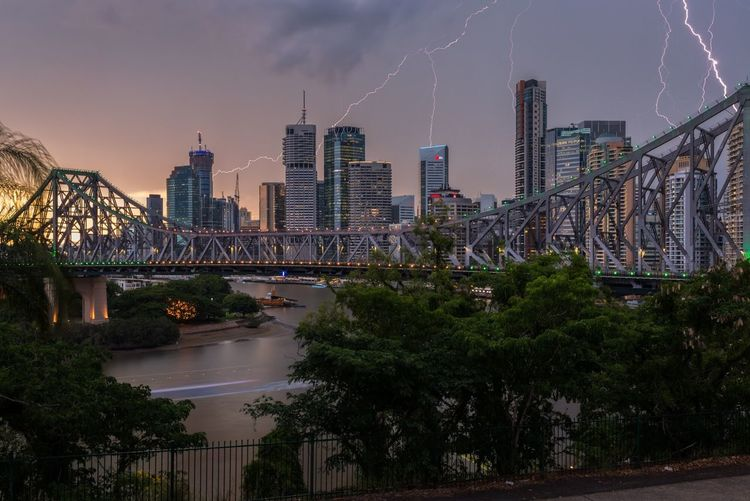 Brisbane City Summer Storm Story Bridge Lightening Brisbane Architecture Skyscraper Building Exterior City Built Structure Cityscape Urban Skyline Sky Travel Destinations Thunderstorm Storm Cloud Water