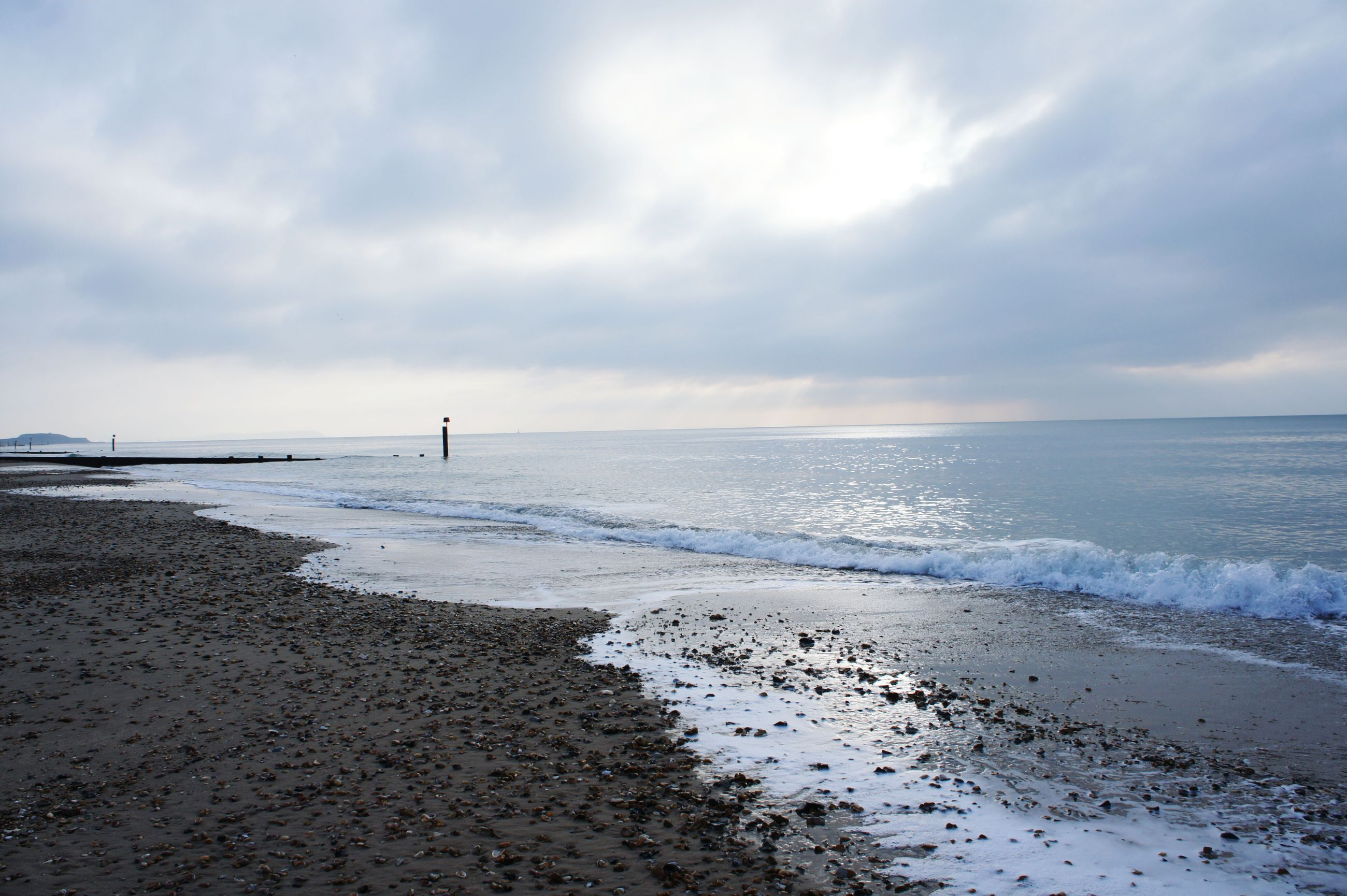 sea, horizon over water, beach, water, sky, shore, scenics, tranquil scene, tranquility, beauty in nature, cloud - sky, sand, nature, cloudy, idyllic, cloud, wave, outdoors, calm, coastline