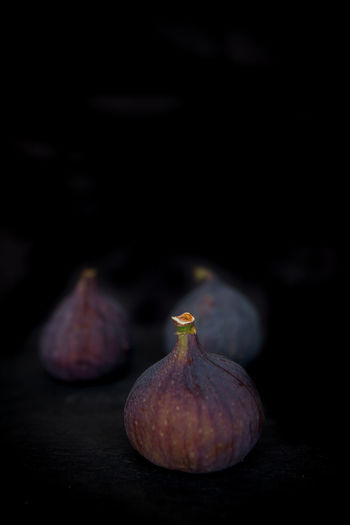 Beautiful fresh blue violet figs on dark stone background with empty copyspace close up vie from above. Freshness Food And Drink Food Healthy Eating Fig Studio Shot Black Background Wellbeing Close-up No People Fruit Indoors  Still Life Copy Space Purple Dark Single Object Organic Ingredient Vegetable Ripe Vegetarian Food