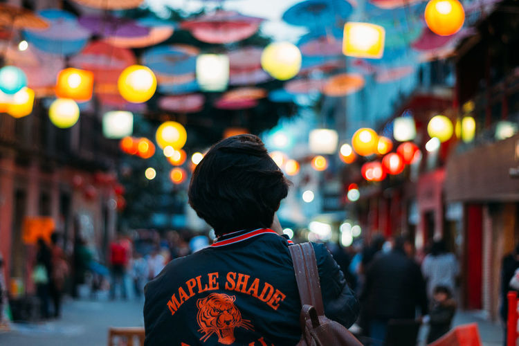 Maple Shade. Architecture Boys Building Exterior Built Structure City Focus On Foreground Illuminated Incidental People Men Night One Person Outdoors People Real People Rear View Street
