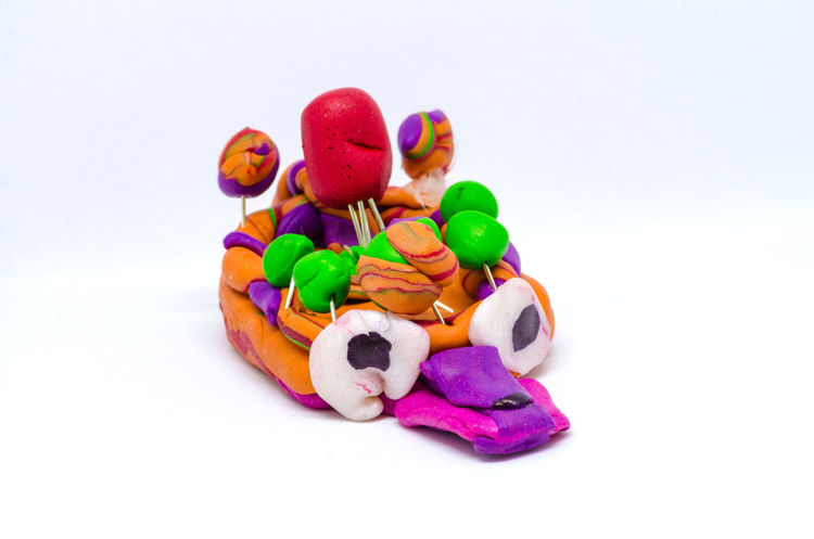 A colourful creation made by a child from modelling clay. ArtWork Colourful HEAD Child's Creation Clay Creation Modelling Clay Multi Colored No People Still Life Studio Shot White Background