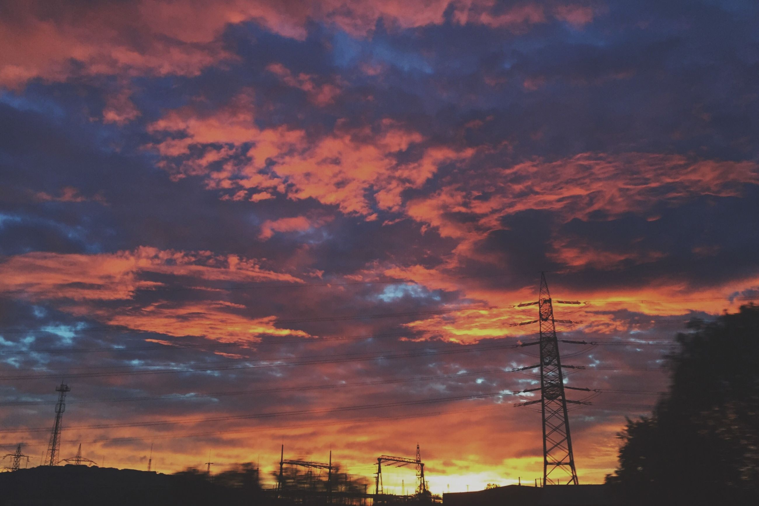 sunset, cloud - sky, sky, electricity pylon, power line, cable, connection, no people, silhouette, electricity, nature, power supply, low angle view, beauty in nature, fuel and power generation, technology, scenics, outdoors, built structure, tree, architecture, day
