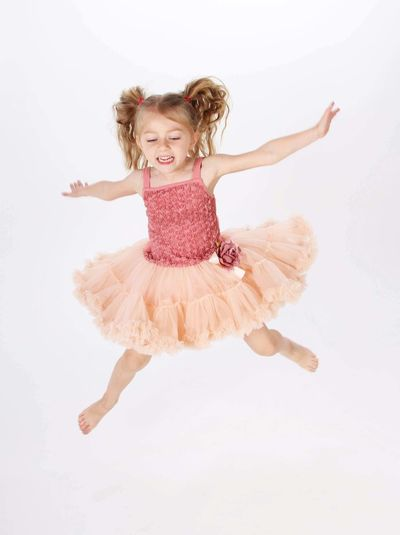 Happy girl jumping against white background