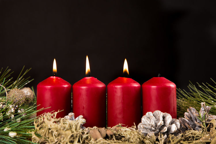 Black Background Burning Candle Celebration Close-up Copy Space Fire Fire - Natural Phenomenon Flame Group Of Objects Heat - Temperature Illuminated In A Row Indoors  Melting Nature No People Red Still Life Studio Shot Tea Light Wax