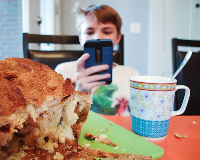 Food And Drink One Person Indoors  Unhealthy Eating Panettone Breakfast Mobile Phone Boy Italian