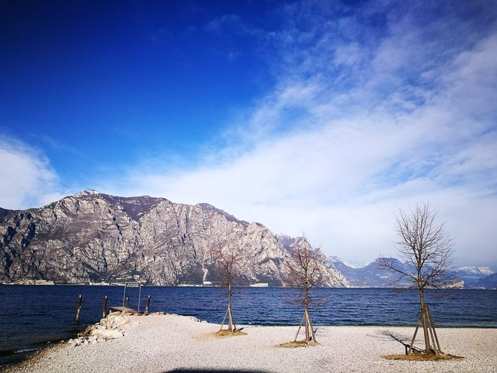 No People Non-urban Scene Non Filter Trees Beauty In Nature Tranquility Tranquil Scene Travel Destinations Sky And Clouds Mountain Over Lake Mountain Over Water Italy Mobile Photography Beauty In Nature Lake View Travel Destinations Travel Photography Travel Mountain Range Shades Of Winter Visual Creativity The Great Outdoors - 2018 EyeEm Awards
