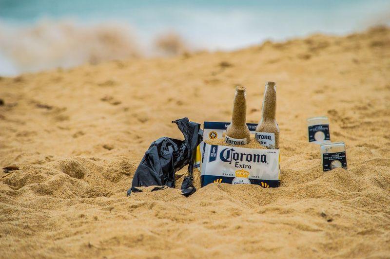Bottle full of sand at beach