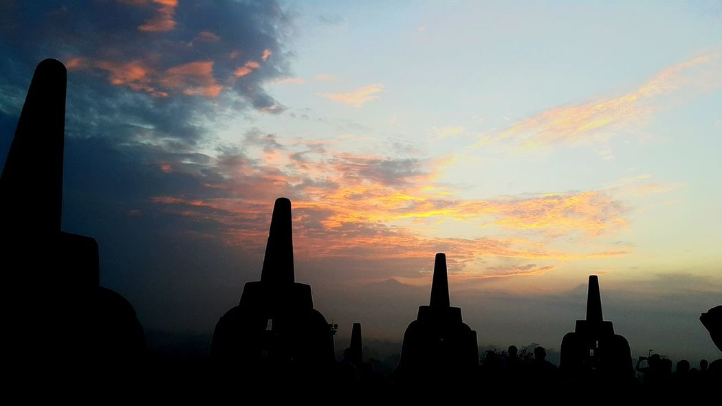 Borobudur sunrise Architecture Business Finance And Industry Travel Destinations Religion Statue Sunset Built Structure Building Exterior Spirituality Urban Skyline Dawn Sculpture Old Ruin Cityscape City No People Ancient Civilization Outdoors Day Wonderful Indonesia Borobudur Sunrise N Sunsets Worldwide  Borobudur Temple Sunrise Silhouette Borobudur Temple, Indonesia