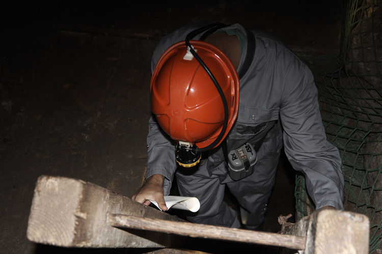 Miner climbing ladder