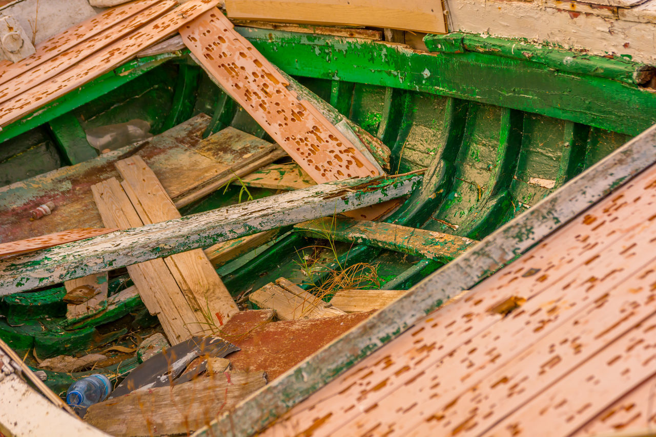 wood - material, no people, day, high angle view, construction industry, architecture, green color, built structure, outdoors, construction site, close-up, industry, old, nature, brick wall, plank, selective focus, metal, bench