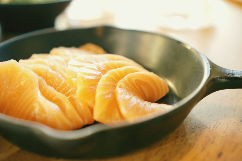 EyeEm Selects SLICE Close-up Food And Drink Skillet- Cooking Pan Cast Iron Prepared Food Sashimi  Sushi Japanese Food Salmon Cooking Pan