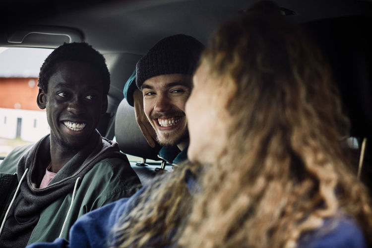 Portrait of smiling young man in car