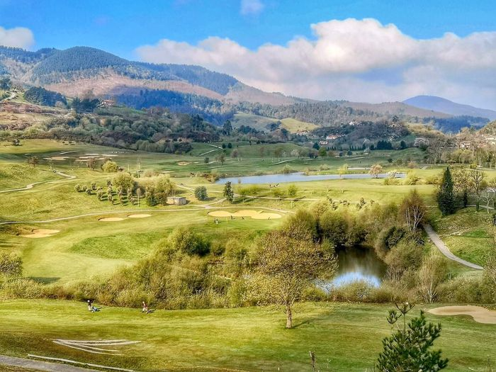 Golf Course Plant Sky Beauty In Nature Scenics - Nature Cloud - Sky Tranquil Scene Mountain Tranquility Landscape Day Land Tree Nature Green Color Field Water