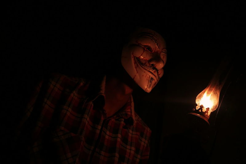 Mix Yourself A Good Time Flame Burning Heat - Temperature Night Self Potrait Portrait Black Background EyeEmNewHere Photography Themes The Week On EyeEm Canonphotography Fine Art Photography Mystery Mask - Disguise Full Length Full Frame Low Light Photography Low Light See The Light