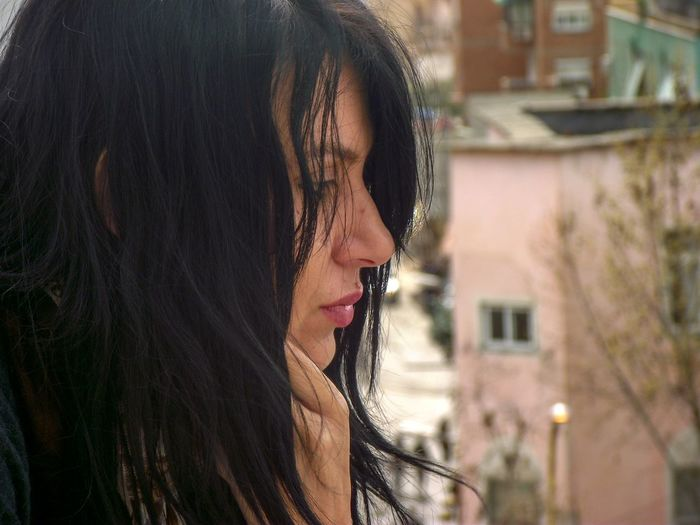 Close-up of thoughtful woman in city