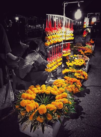 Yellow flowers for sale at market stall