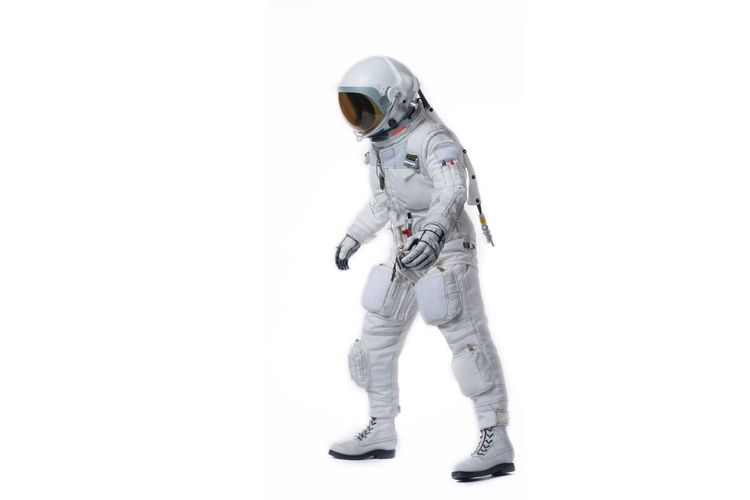Astronaut standing against white background