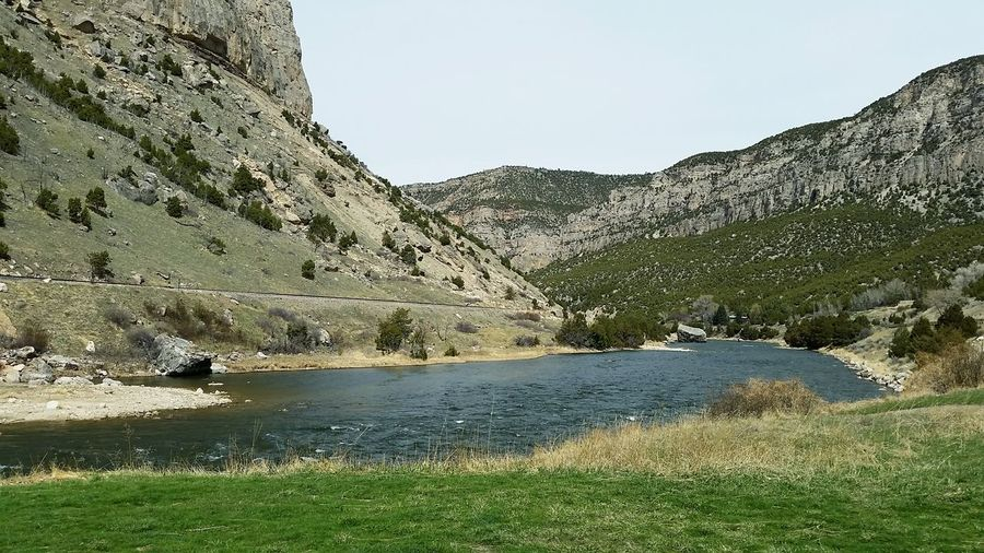 Spring time Canyon River Water Mountain Lake Sky Grass Rocky Mountains Rugged Rock - Object Mountain Range Physical Geography Countryside Eroded Cliff Natural Landmark Tranquility Tranquil Scene