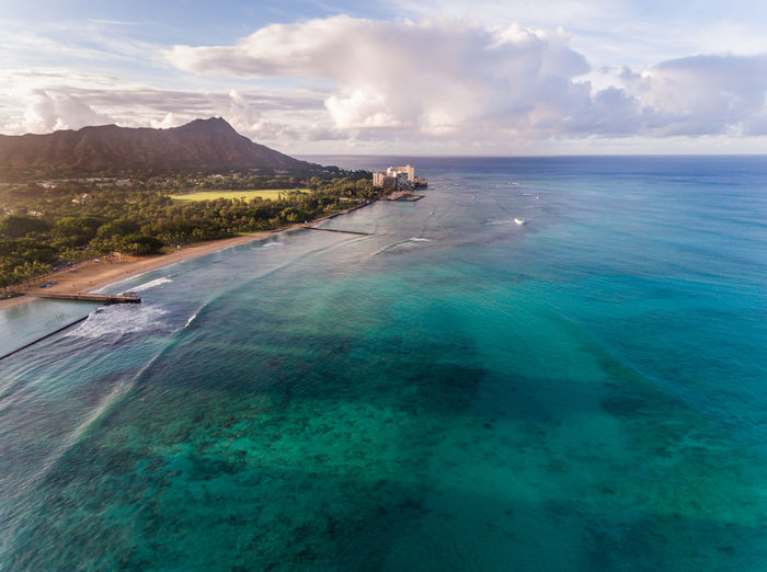 Aerial view of Diamond Head and the Beach in Honolulu Hawaii Honolulu, Hawaii Oahu Pacific View Waikiki Beach Aerial Beach Beauty In Nature Blue Cloud - Sky Day Horizon Over Water Idyllic Mountain Nature Ocean Outdoors Scenics Sea Sky Tranquil Scene Tranquility Tropical Water Waterfront