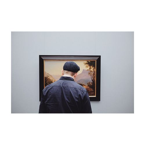 Taking a photo while looking at art. Museum Art Rear View One Person Transfer Print Architecture Men Auto Post Production Filter Frame Lifestyles Real People Standing Indoors  Built Structure Adult