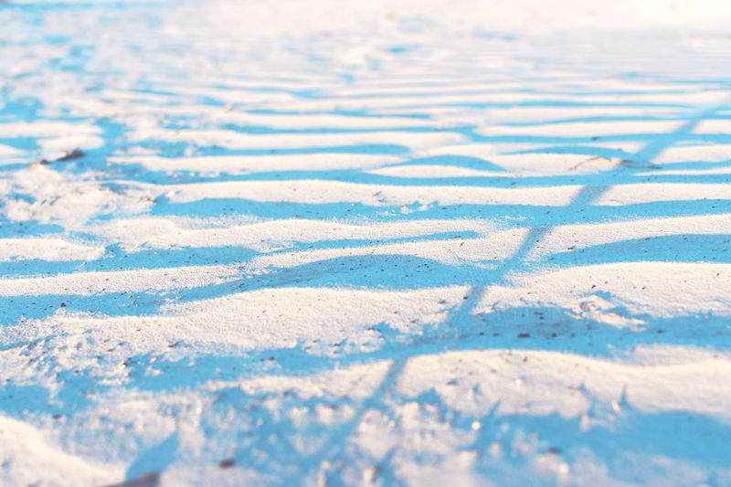 High Angle View Of Shadow On Snow Covered Field