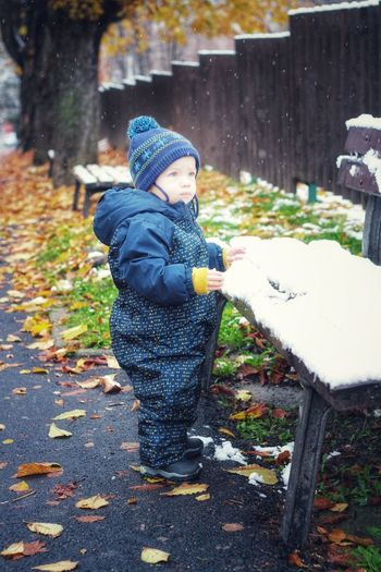 Boy standing in park during winter