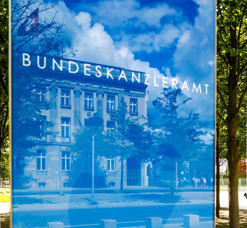 Architecture Blue Building Exterior Built Structure Bundeskanzleramt Bundesregierung Chancellery Chancellor Close-up Communication Day Government Government Building Inside Kanzleramt Nature No People Outdoors Reflection Sign Sky Text Text Tree