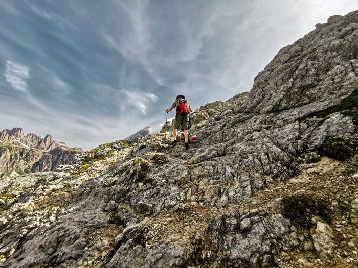 Rear view of man hiking on mountain