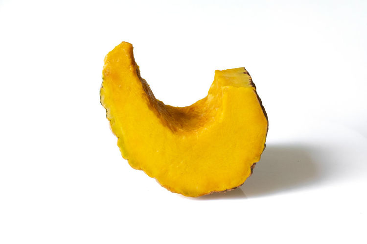 Close-up of yellow fruit against white background