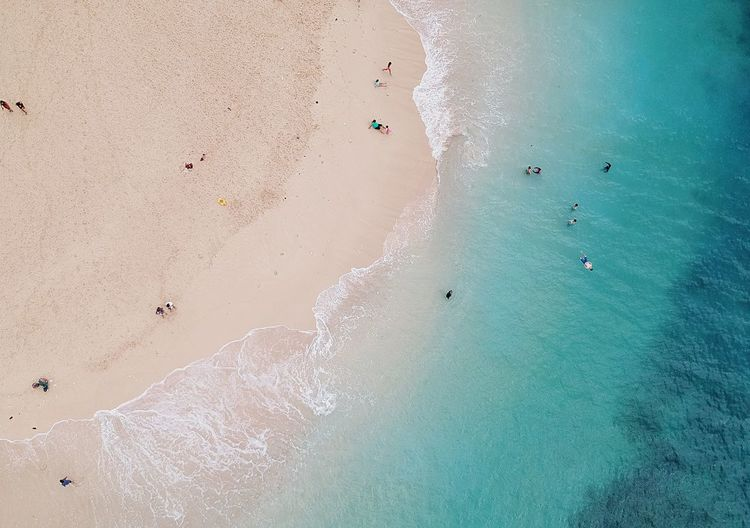 Aerial View Of People On Shore At Beach