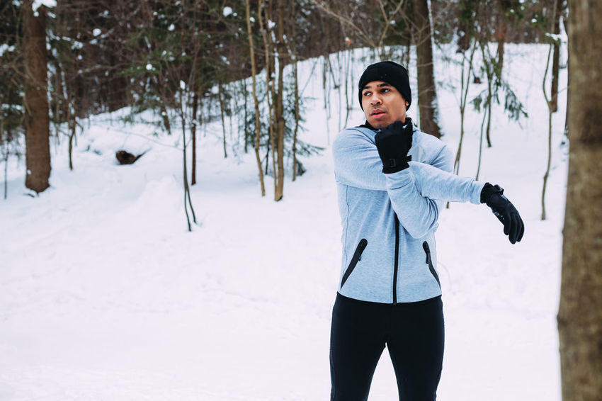 Winter Tree One Person Snow Cold Temperature Real People Clothing Day Outdoors Warm Clothing Athlete Runner Sportsman Front View Copy Space Warming Up Standing