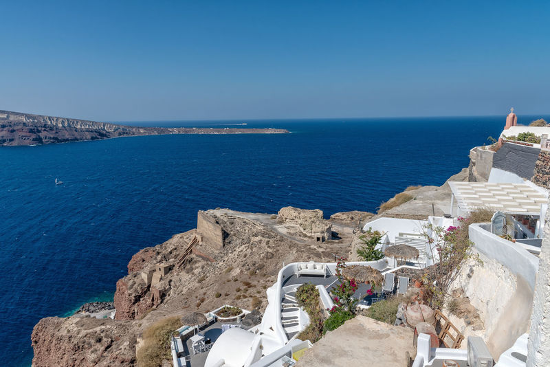 View of Oia - Santorini Cyclades Island - Aegean sea - Greece Greece Santorini Oia Island Maditerranean Sea Volcano Caldera Aegean Cyclades Water Horizon Over Water Horizon Scenics - Nature Architecture Beauty In Nature Blue Land Nature Built Structure Beach High Angle View Rock Travel Destinations Travel