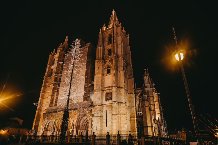 Building Exterior Architecture Built Structure Night Place Of Worship Religion Low Angle View Belief Building Spirituality Sky Travel Destinations Illuminated The Past History Nature Travel Tourism No People Gothic Style Lens Flare Spire  Christmas Christmas Lights Cathedral
