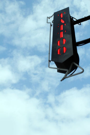 Abstract Street Scene Close-up Cloud - Sky Communication Day Guidance Illuminated Low Angle View No People Outdoors Red Light Road Sign Signal Sky Stoplight Tattoo Parlour