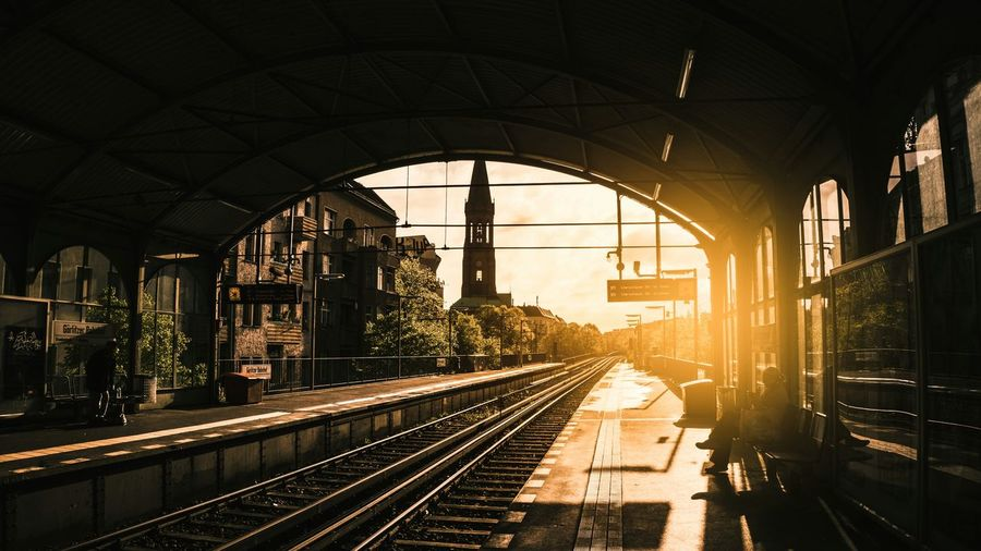 Picture of a trainstation with orange sun beam and view over environment