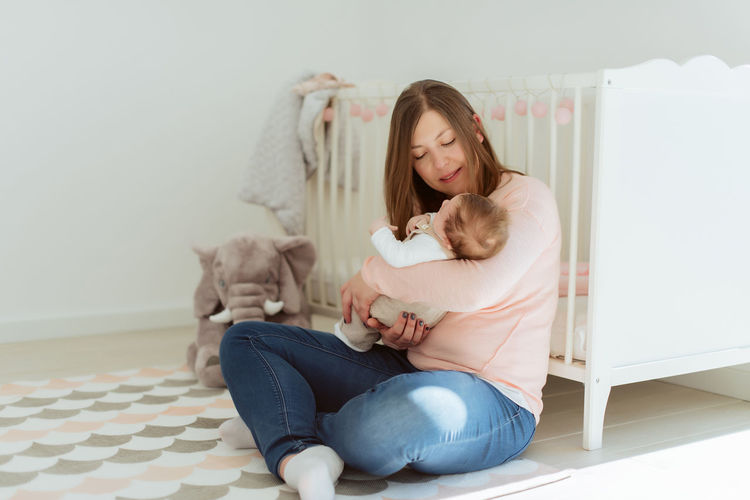 Woman with cat sitting at home