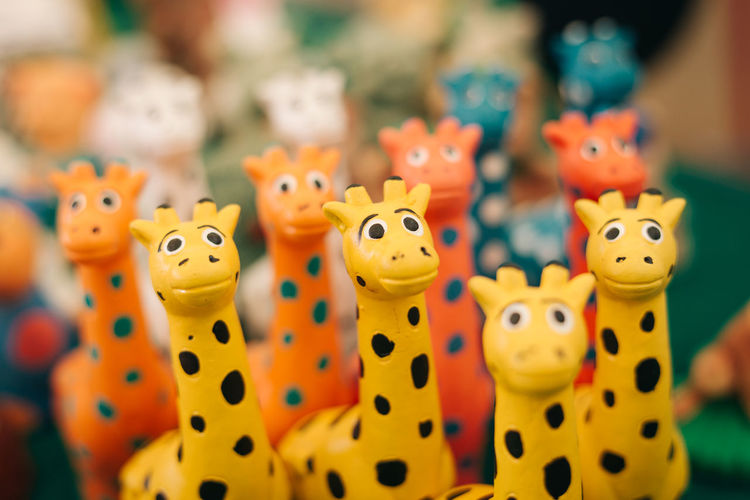 Close-Up Of Giraffe Toys For Sale At Shop